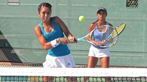 Jasmine Almaguer cuts the point short with a backhand volley as her partner, Courtney Pattagalan, looks on during their women's doubles victory at the 2013 iTennis/Andulka Park Adult Open Tennis Championships.