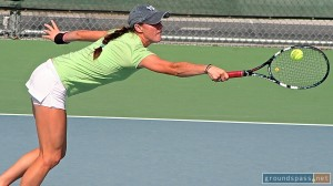 Kaitlyn Christian stretches out to get a backhand back in play at the 2013 iTennis/Andulka Park Adult Open Tennis Championships.