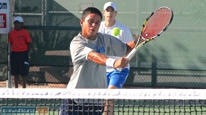 Maxime Tabatruong slices at the net as his partner, Amit Inbar, watches from the back court during their championship win at the 2013 iTennis/Andulka Park Adult Open Tennis Championships.